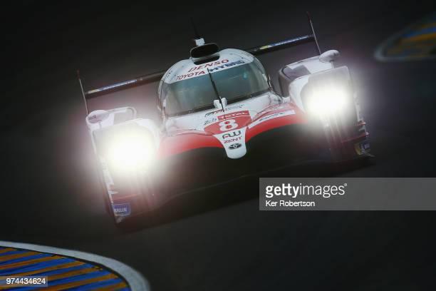 The Toyota Gazoo Racing TS050 Hybrid of Fernando Alonso, Sebastien Buemi and Kazuki Nakajima drives during qualifying for the Le Mans 24 Hour race at...
