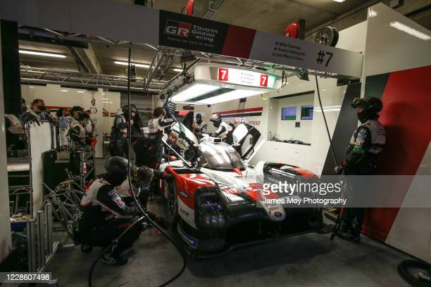 The Toyota Gazoo Racing TS050 Hybrid of Mike Conway, Kamui Kobayashi, and Jose Maria Lopez in the pits at the Circuit de la Sarthe on September 19,...