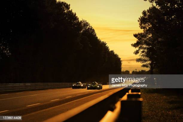 The Toyota Gazoo Racing TS050 Hybrid of Mike Conway, Kamui Kobayashi, and Jose Maria Lopez in action at sunrise at the Circuit de la Sarthe on...