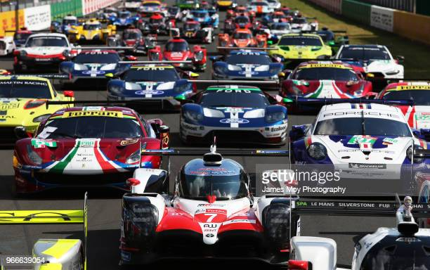 The Toyota Gazoo Racing TS050 Hybrid of Mike Conway Kamui Kobayashi Jose Maria Lopez Fernando Alonso and Anthony Davidson lines up with the other...