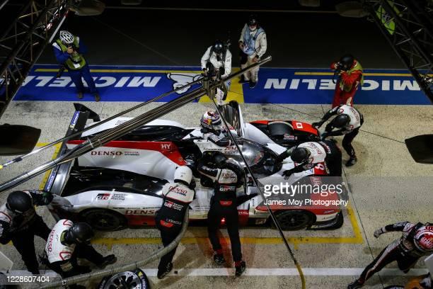 The Toyota Gazoo Racing TS050 Hybrid of Sebastien Buemi, Kazuki Nakajima, and Brendon Hartley makes a pit stop at the Circuit de la Sarthe on...
