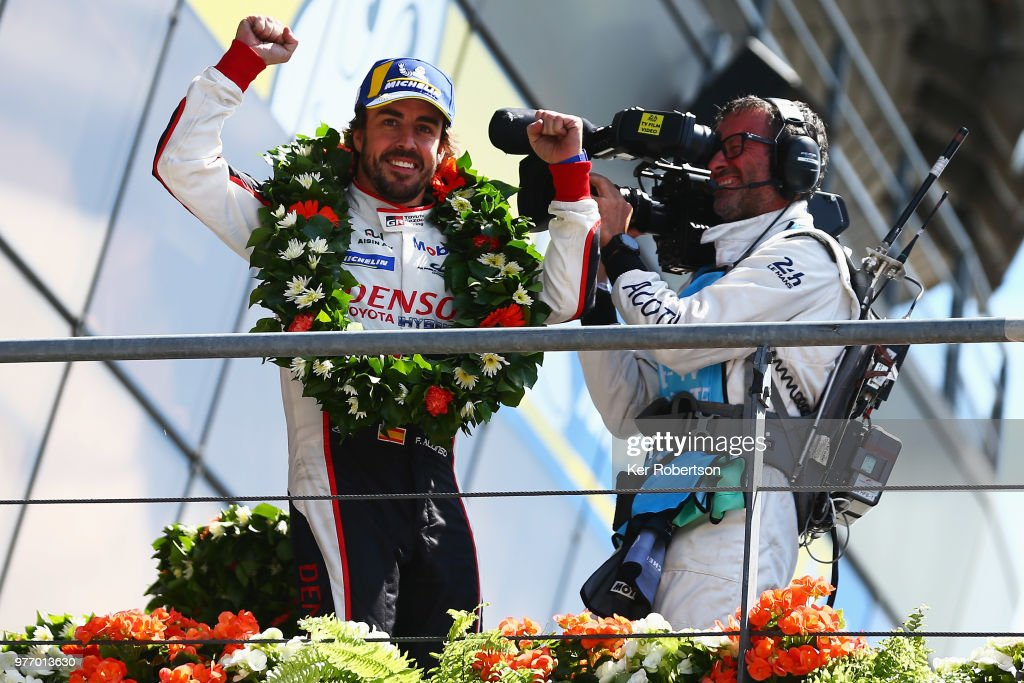 The Toyota Gazoo Racing TS050 Hybrid team driver Fernando Alonso reacts as he and co drivers Kazuki Nakajima and Sebastien Buemi celebrate after Toyota win for the first time at the Le Mans 24 Hour race at the Circuit de la Sarthe on June 17, 2018 in Le Mans, France.