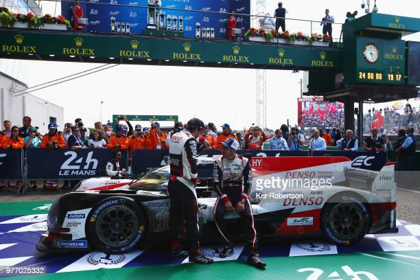 The Toyota Gazoo Racing TS050 Hybrid team of Fernando Alonso and Sebastien Buemi sit on their car in the winners area as Toyota win for the first...