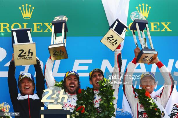 The Toyota Gazoo Racing TS050 Hybrid team of Fernando Alonso Sebastien Buemi and Kazuki Nakajima celebrate alongside Shigeki Tomoyama of Toyota after...