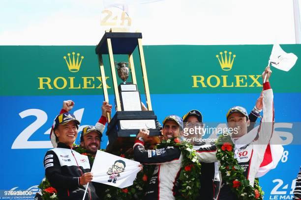The Toyota Gazoo Racing TS050 Hybrid team of Fernando Alonso, Sebastien Buemi and Kazuki Nakajima celebrate alongside Shigeki Tomoyama and Hisatake...