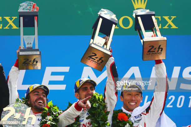 The Toyota Gazoo Racing TS050 Hybrid team of Fernando Alonso Sebastien Buemi and Kazuki Nakajima celebrate after Toyota win for the first time at the...