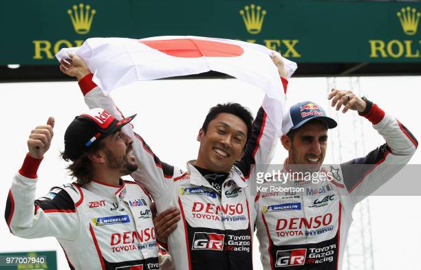 The Toyota Gazoo Racing TS050 Hybrid team of Fernando Alonso Kazuki Nakajima and Sebastien Buemi celebrate after Toyota win for the first time at the...