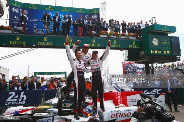 The Toyota Gazoo Racing TS050 Hybrid team of Kazuki Nakajima Fernando Alonso and Sebastien Buemi celebrate after Toyota win for the first time at the...
