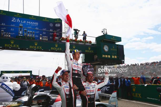 The Toyota Gazoo Racing TS050 Hybrid team of Sebastien Buemi Kazuki Nakajima and Fernando Alonso celebrate after Toyota win for the first time at the...