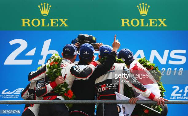 The Toyota Gazoo Racing TS050 Hybrid team pose for a selfie after Toyota win for the first time at the Le Mans 24 Hour race at the Circuit de la...
