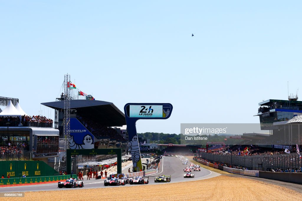 The Toyota Gazoo Racing TS050 of Mike Conway, Kamui Kobayashi and Stephane Sarrazin leads the field into the first corner during the rolling start for the Le Mans 24 Hour Race at Circuit de la Sarthe on June 17, 2017 in Le Mans, France.