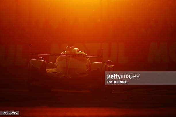 The Toyota Gazoo Racing TS050 of Mike Conway Kamui Kobayashi and Stephane Sarrazin drives at sunset during the Le Mans 24 Hours race at the Circuit...