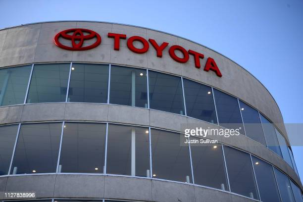 The Toyota logo is displayed at One Toyota of Oakland on February 06, 2019 in Oakland, California. Toyota reported a $12.6 billion loss in third...
