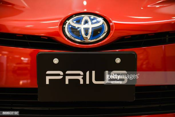 The Toyota Motor Corp badge is displayed on a Prius hybrid vehicle at the visitor center of the company's Tsutsumi plant in Toyota City Aichi Japan...
