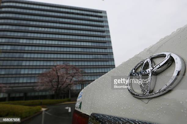 The Toyota Motor Corp. Badge is displayed on the real of a vehicle outside the company's headquarters in Toyota City, Aichi Prefecture, Japan, on...