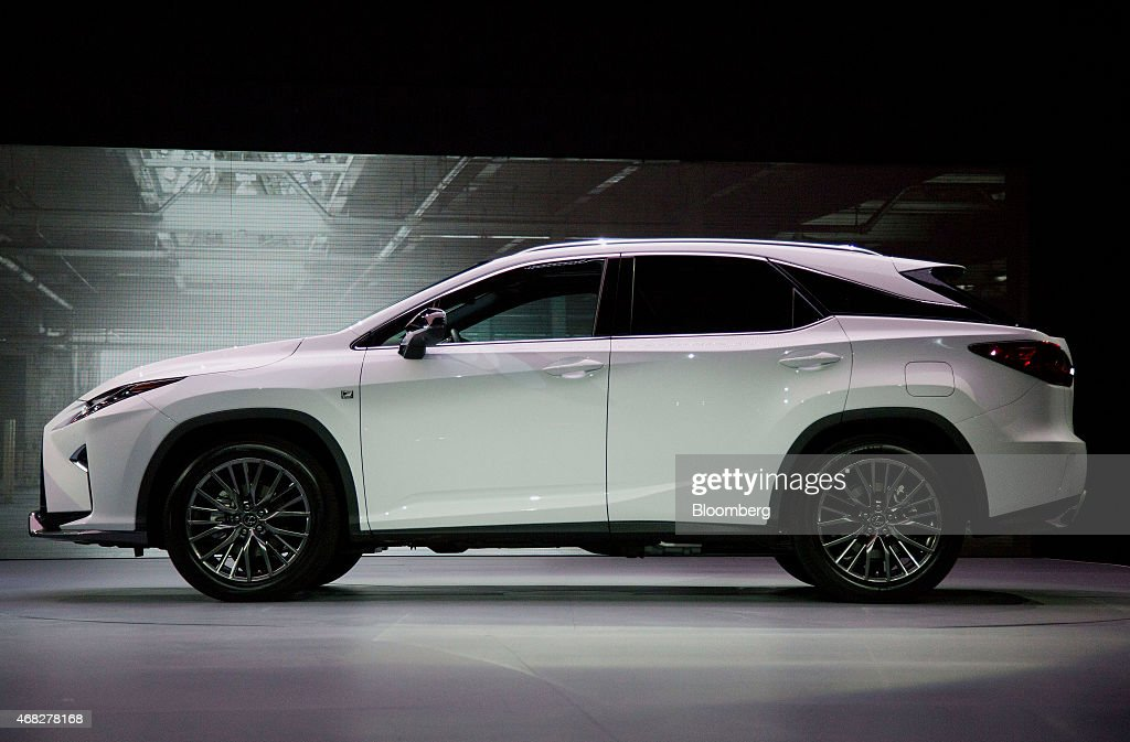 The Toyota Motor Corp. Lexus RX sports utility vehicle (SUV) is unveiled during the 2015 New York International Auto Show in New York, U.S., on Wednesday, April 1, 2015. The battle for leadership of the U.S. luxury auto market heats up when Lexus and Mercedes-Benz debut new SUVs today. Lexus is introducing a new version of its RX, the brand's most popular vehicle. Photographer: Michael Nagle/Bloomberg via Getty Images