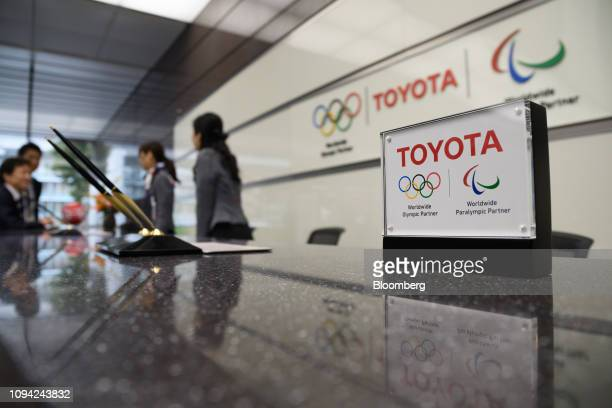 The Toyota Motor Corp logo is displayed at the company's head office in Tokyo Japan on Wednesday Feb 6 2019 Toyota cut its fullyear netincome...