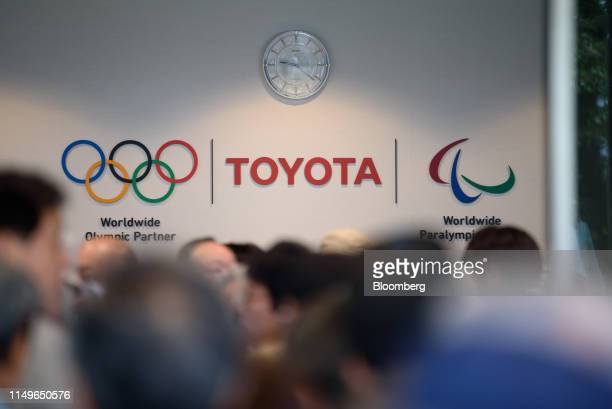 The Toyota Motor Corp. Logo is displayed at the company's headquarters as shareholders arrive for the annual meeting in Toyota, Aichi Prefecture,...