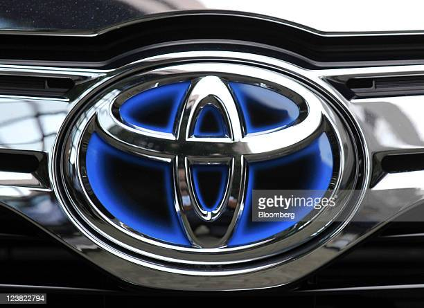 The Toyota Motor Corp logo is seen on the company's Camry hybrid sedan during an unveiling in Tokyo Japan on Monday Sept 5 2011 Toyota Motor Corp the...