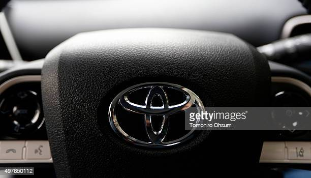 The Toyota Motor Corp logo is seen on the steering wheel of a prottype of the company's fourthgeneration Prius hybrid vehicle during the test drive...
