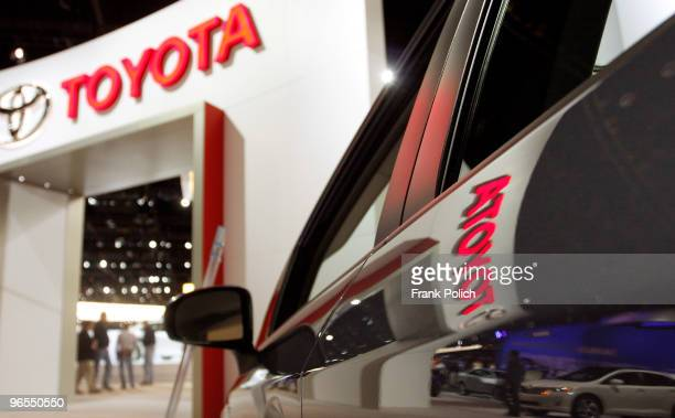The Toyota name and logo are reflected in Prius on display during the first Media preview day of the Chicago Auto Show February 10 in Chicago...
