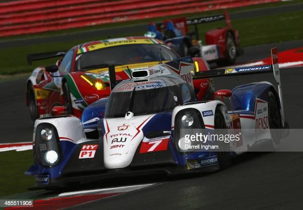 The Toyota Racing Toyota TS040 Hybrid LMP1 driven by Kazuki Nakajima of Japan, Stephane Sarrazin of France and Alexander Wurz of Austria during...