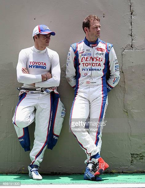 The Toyota Racing Toyota TS040 Hybrid LMP1 driver Alexander Wurz of Austria and Stephane Sarrazin of France looks on before the FIA World Endurance...