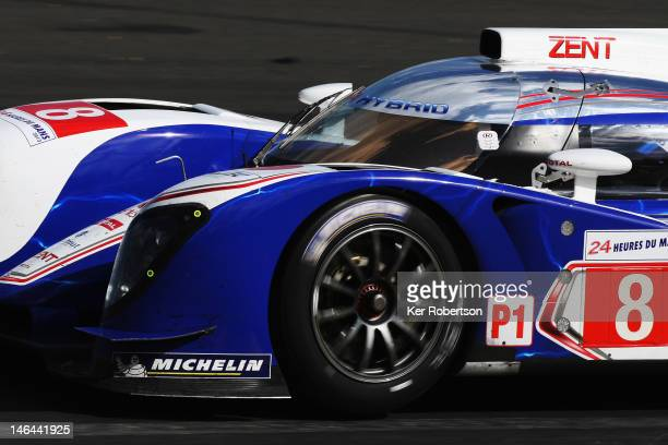 The Toyota Racing TS030 Hybrid of Antony Davidson Sebastien Buemi Stephane Sarrazin drives before its accident during the Le Mans 24 Hour race at the...