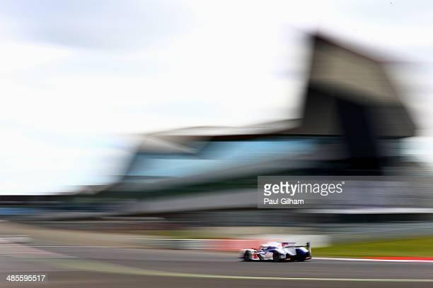The Toyota Racing TS040 Hybrid LMP1 driven by Kazuki Nakajima of Japan, Stephane Sarrazin of France and Alexander Wurz of Austria on its way to...