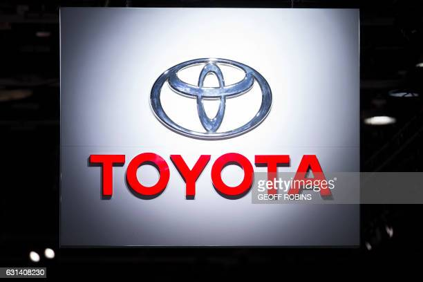 The Toyota sign hangs over the company's booth at the 2017 North American International Auto Show in Detroit, Michigan, January 10, 2017.