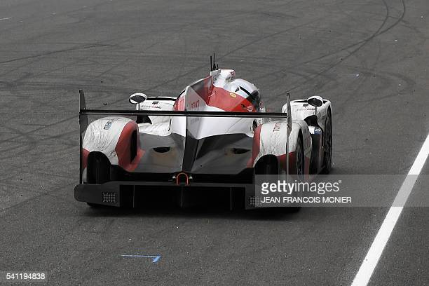 The Toyota TSO50 Hybrid N°5 driven by Japan's Kazuki Nakajima is pictured at a standstill on the race track after it suffered engine failure in the...