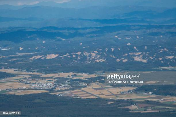 The trace of landslide by big earthquake on the green hill in Atsuma town in Hokkaido daytime aerial view from airplane