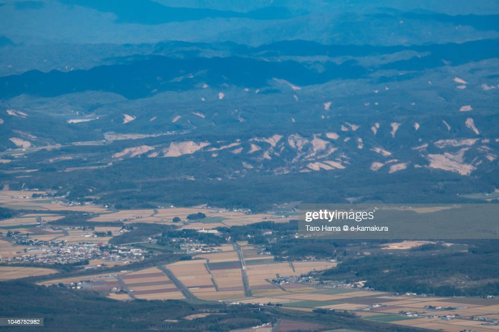 The trace of landslide by big earthquake on the green hill in Atsuma town in Hokkaido daytime aerial view from airplane : ストックフォト