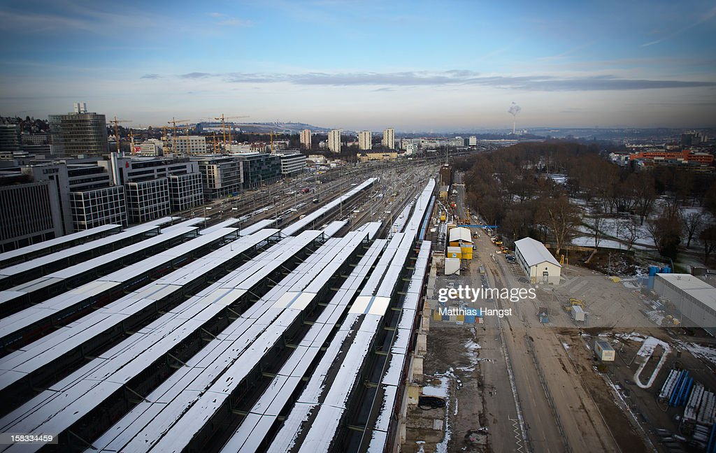 The track and the construction site of the Stuttgart 21 railway station seen from the overview platform on the top of the tower of the Hauptbahnhof on December 13, 2012 in Stuttgart, Germany. German state rail carrier Deutsche Bahn, which is carrying out the massive project, announced yesterday that final costs will be EUR 1.1 billion more than previously expected, bringing the total cost to EUR 5.6 billion. The project will replace the current overground, terminal station with a more efficient underground one. Critics have decried the project as too expensive and too environmentally risky.