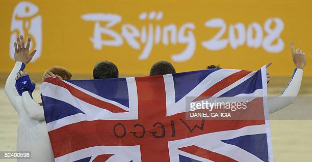 The track cycling team of Great Britain, celebrates after winning the gold medal in the 2008 Beijing Olympic Games men's team pursuit finals at the...