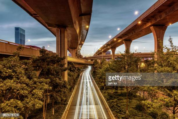 the track of the city nightview - kunming stock pictures, royalty-free photos & images