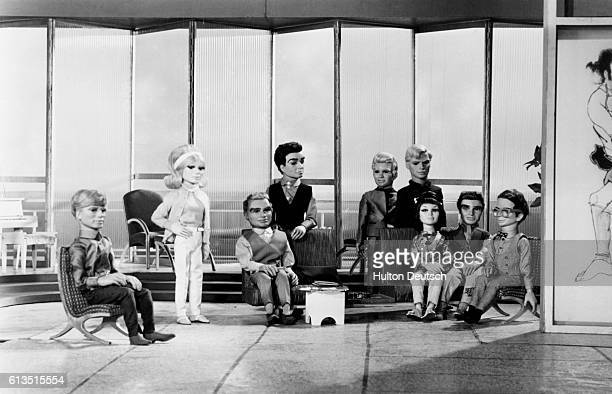 The Tracy family and allies of International Rescue the heros of the futuristic 'Supermarionation' television show Thunderbirds Seated center is...