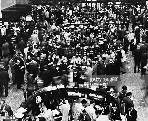 The trading floor of the New York Stock Exchange bustles with activity. May 30, 1962.