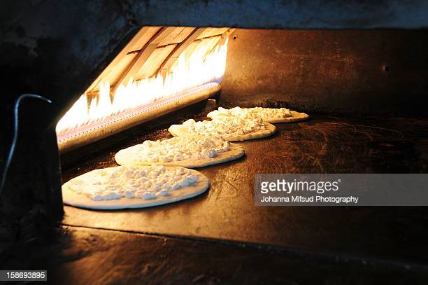 the tradition of manakish bread, lebanon - beirut stock pictures, royalty-free photos & images