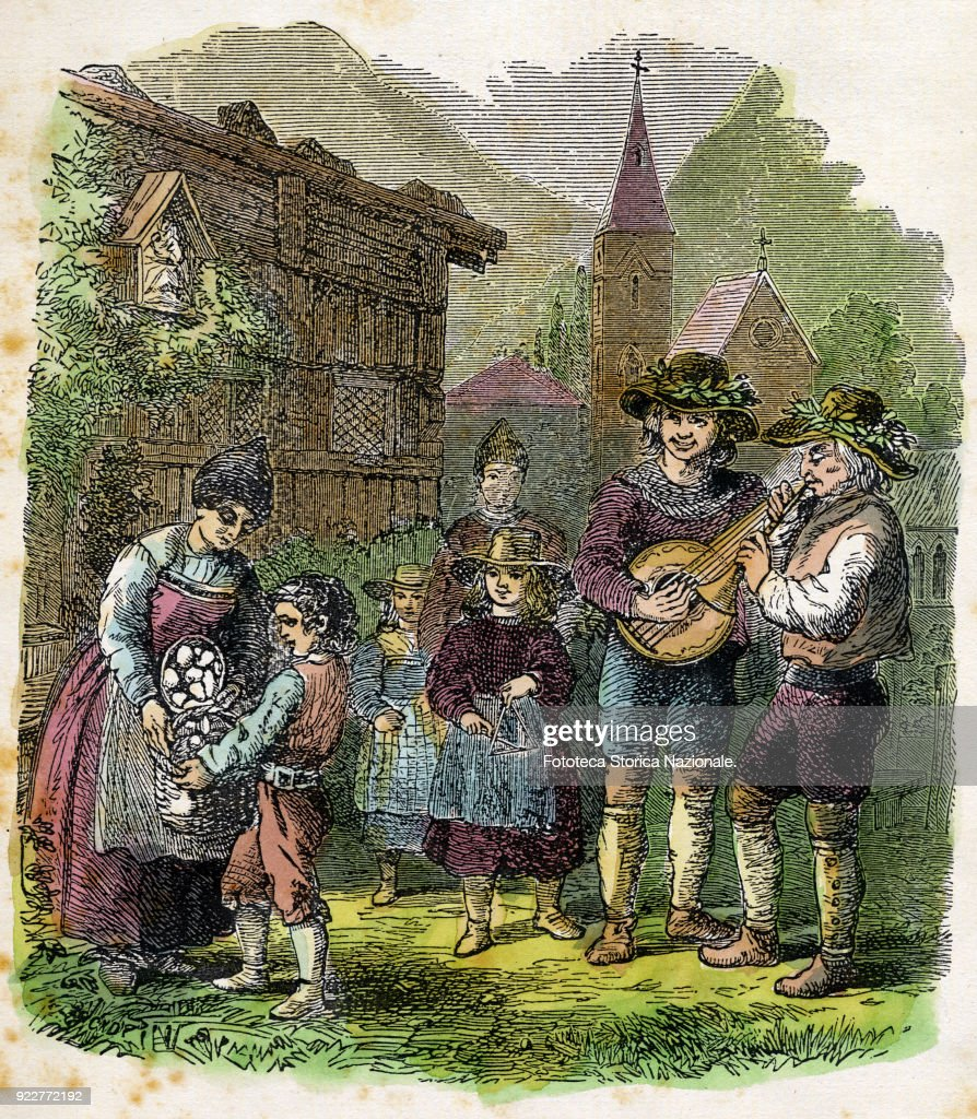 The traditional 'begging of eggs' propitiatory performed on the occasion of Easter. Accompanied by songs and popular music, the children went from house to house to collect the eggs donated by the villagers. The egg quest is a tradition present in many places in central and northern Italy and is a ritual linked to the return of Spring and propitiatory celebrates its flowering. Colored engraving, Italy approx 1850.