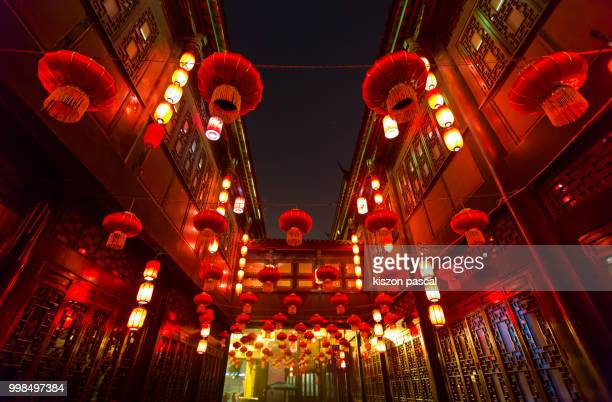 the traditional red lantern in a street of Chengdu in Sichuan during a Chinese new year . China