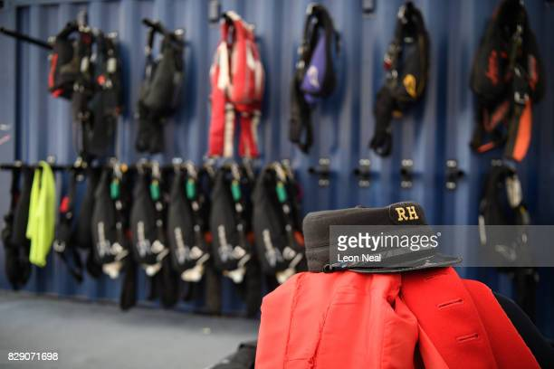 The traditional scarlet coat of Chelsea pensioner Mike Smith is seen near to parachute supplies ahead of his 100th skydive, at the Old Sarum airfield...