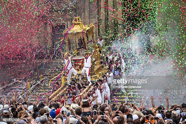 """The traditional """"sciuta"""" of San Paolo, in Palazzolo Acreide, province of Siracusa, Italy. The simulacrum of San Paolo is carried on a palanquin out..."""