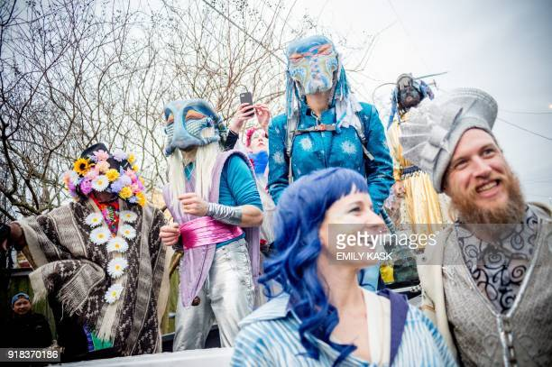 The traditional Skull and Bones Gang wake up residents of the Tremé neighborhood of New Orleans on Mardi Gras morning February 13 2018 / AFP PHOTO /...