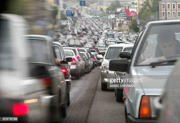 The traffic jam is seen in a car's mirror at the Garden Ring road in Moscow, 25 May 2005. A massive power outage caused chaos in Moscow, stranding...