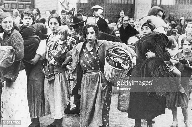 The tragedy of the Spanish Civil War is seared into the faces of these women and children fleeing from their shattered homes in Madrid | Location...
