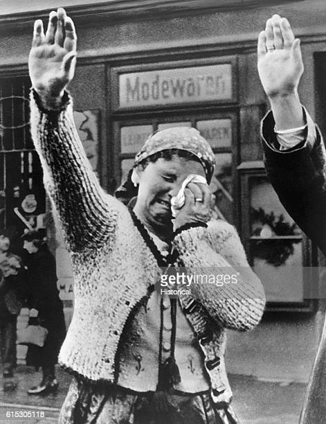 The tragedy of this Czech woman unable to conceal her misery as she dutifully salutes the triumphant Hitler after Germany's annexation of the...