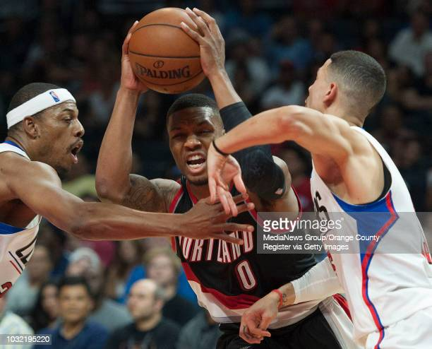 The Trail Blazers' Damian Lillard runs into the Clippers' Paul Pierce left and Austin Rivers during the Clippers' 115109 victory in their last...