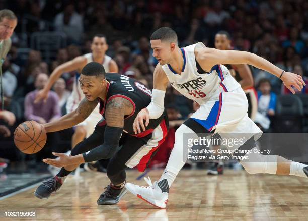 The Trail Blazers' Damian Lillard steals the ball from the Clippers' Austin Rivers during the Clippers' 115109 victory in their last preseason...