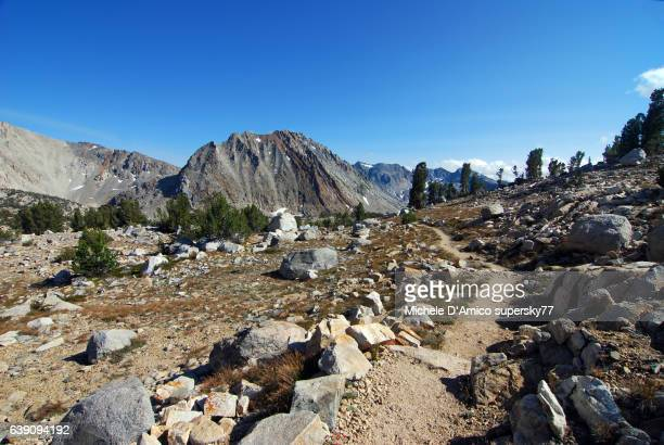 the trail in the high altitude sierra nevada landscape - john muir trail stock photos and pictures